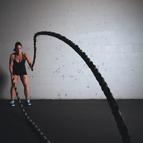 Woman exercising with ropes